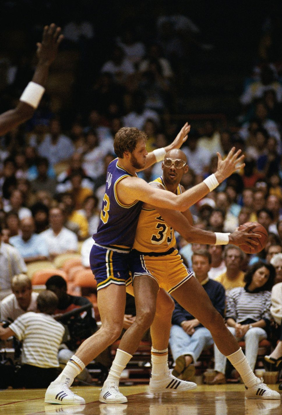 7e6ea53f9d5 Mark Eaton of the Utah Jazz seems to have Los Angeles Lakers player Kareem  Abdul-Jabbar in hand during their NBA playoff game at the Forum in  Inglewood, ...