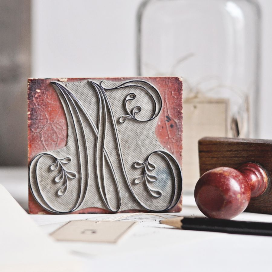 """This is a large antique French monogram stamp.It has a pretty letter M.It was originally used for embroidering linens.Great for decorating a studio or craft space.If used for stamping, it works best on thicker papers.3 5/8"""" x 3 1/4""""9.3 x 8.1 cm"""