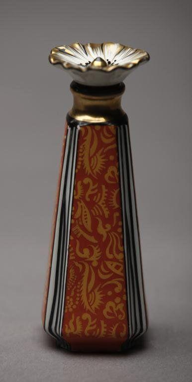 NORITAKE ART DECO SCENT BOTTLE Patterned orange glaze with flower stopper.