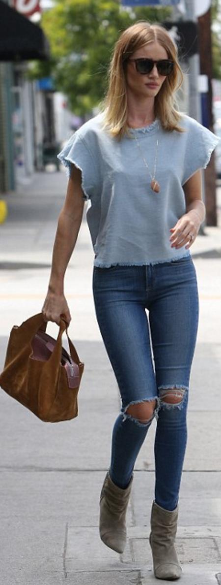 Rosie Huntington-Whiteley: Jeans – Paige  Purse – The Row  Shirt – Iro  Necklace – Cvc Stones  Earring – Anita Ko  Ring – Neil  Shoes – Isabel Marant La  Sunglasses – Saint Laurent