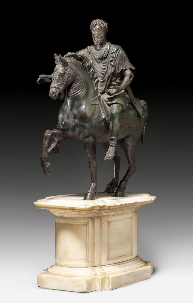 "EQUESTRIAN STATUE OF MARCUS AURELIUS, late Baroque, Rome, 18th/19th centuy. Patinated bronze and ""Carrara"" marble - Dim: 31x18.5x55 cm."