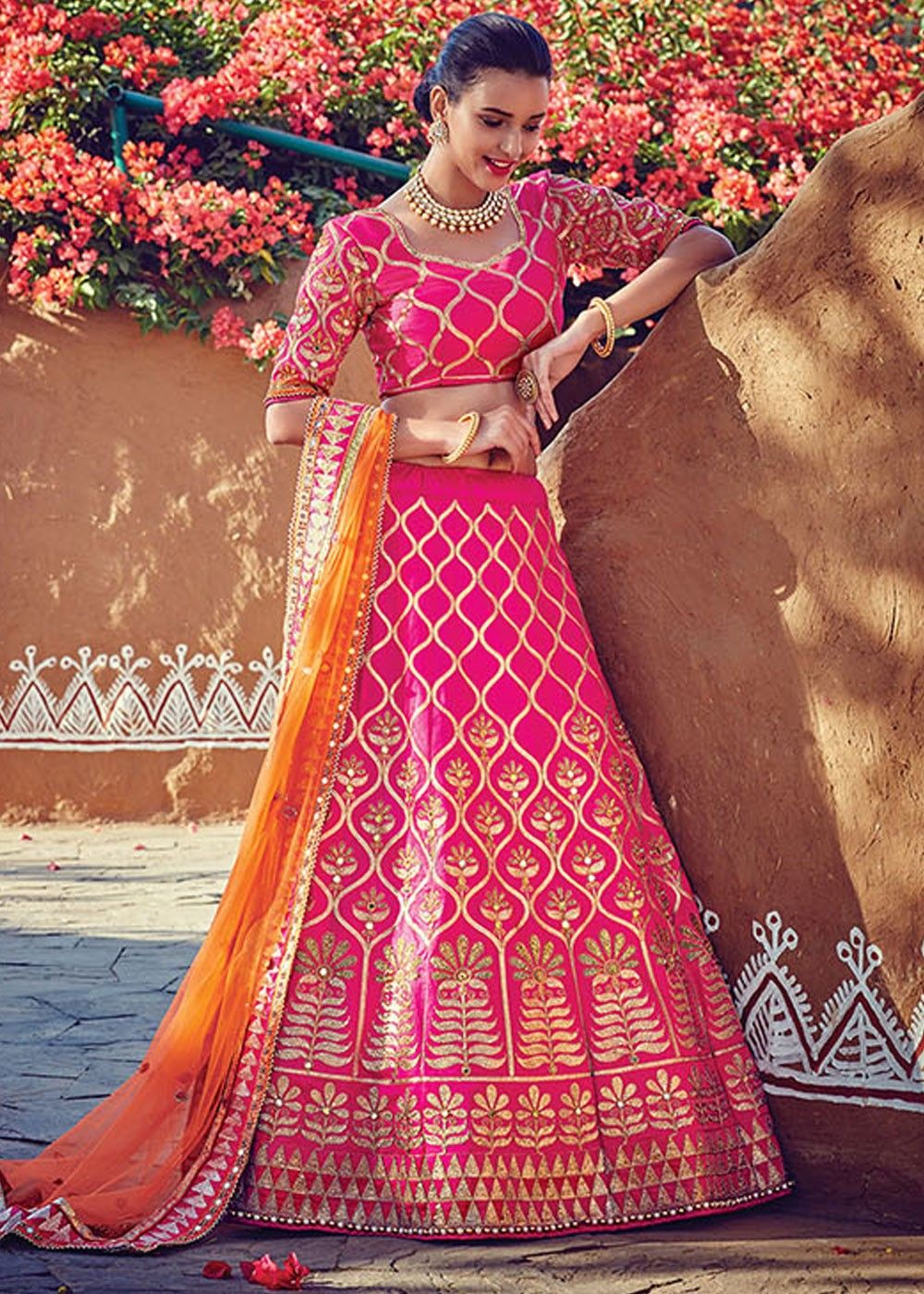26dfa6d777 Look gracious by wearing this #pink #art silk #lehenga adorned with heavy #gota  patti and golden zari work all over.