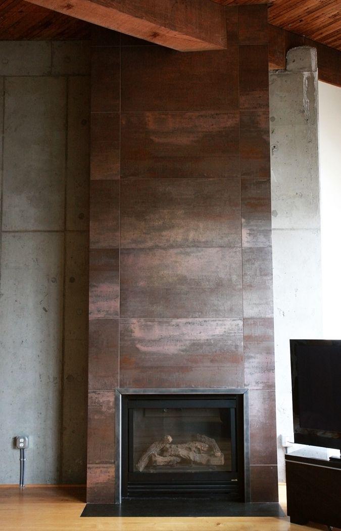 Corten tiles around fireplace  Casa_Vlad