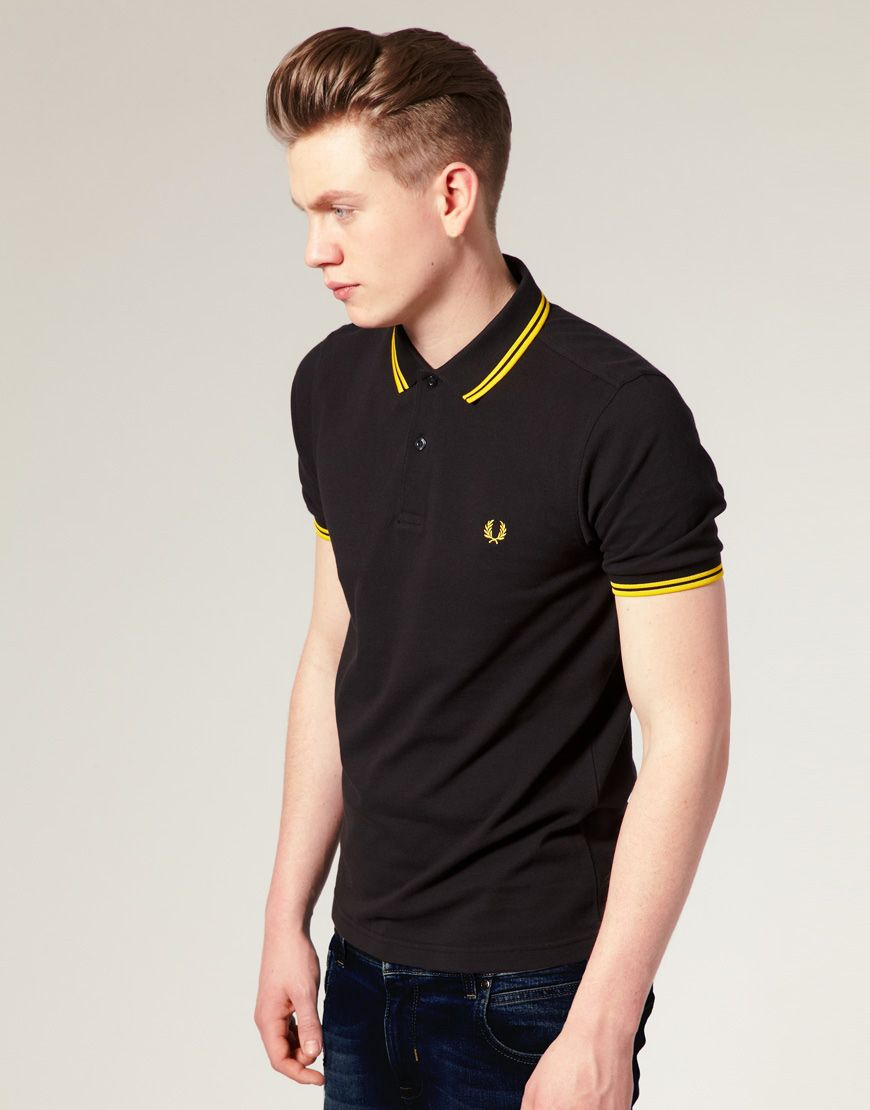 45d4d7851 I own probably a dozen or so Fred Perry s ranging from skin-tight and crisp  brand new shirts (like this black one with yellow tipping)