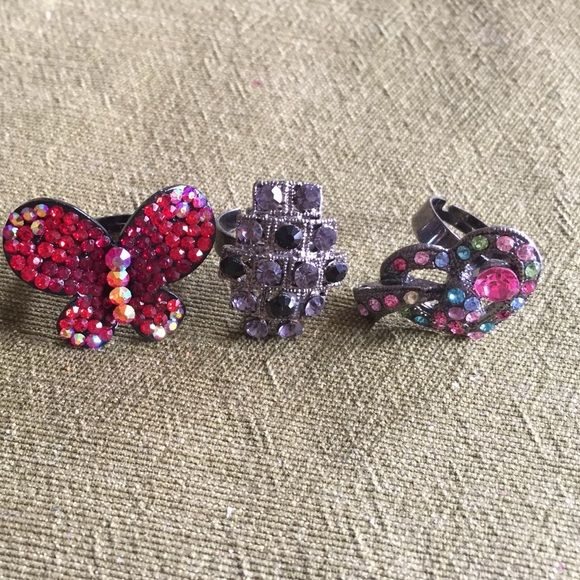 Set of adjustable rings. Butterfly, heart, grey with black rings set. They are adjustable ! Jewelry