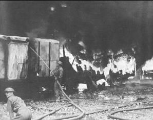 Firefighters Battle The Results Of A Japanese Air Raid On