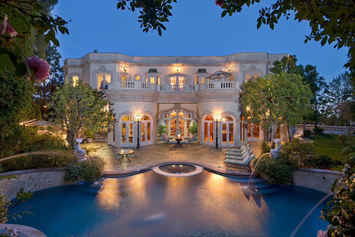 Big Beautiful Mansions With Pools photo of pool and the back of natalie glosman's $19 million