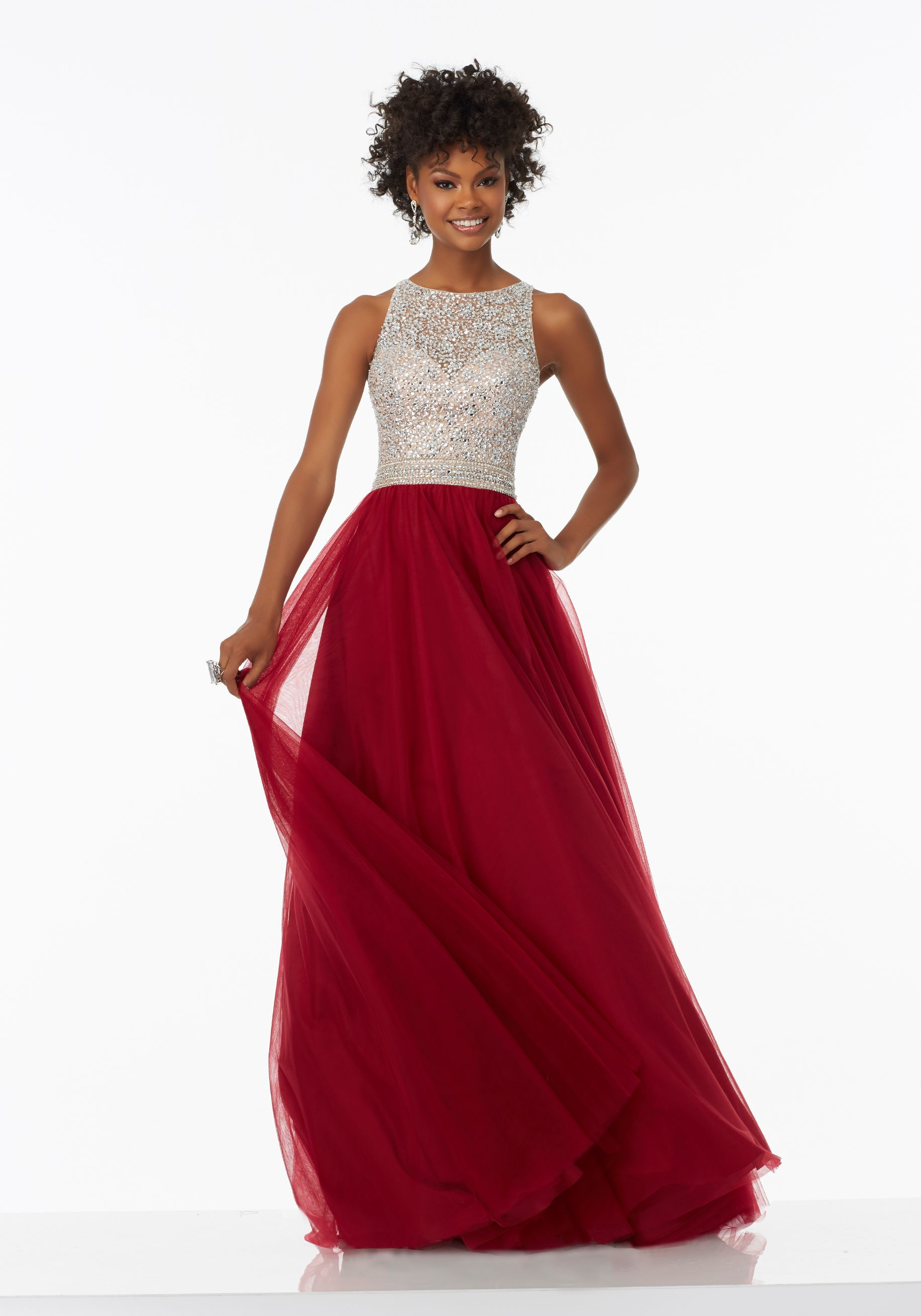 Aline prom dress featuring a fully beaded bodice and soft net skirt