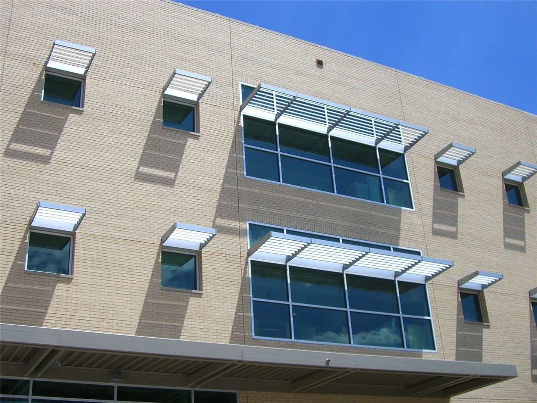 Amazing Aluminum Sunshades Block Sunlight On A Office Building