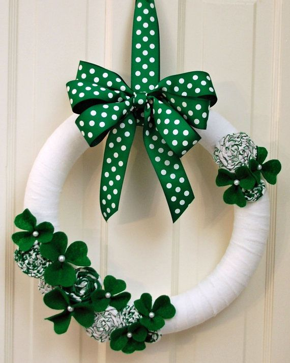 i like the ribbon wrapped wreath maybe different colors with a monogram for the door??