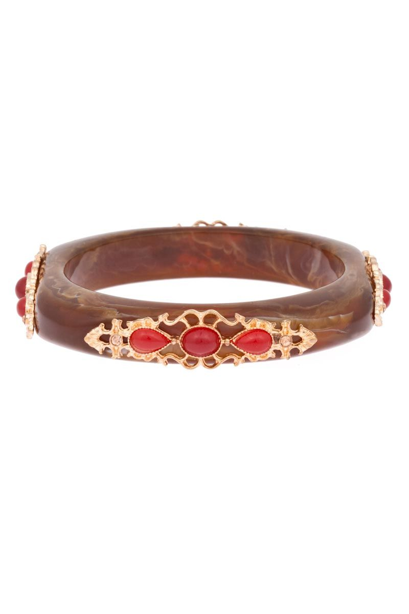 Agatha Antique Resin Bangle is the epitome of vintage-chic timelessness.