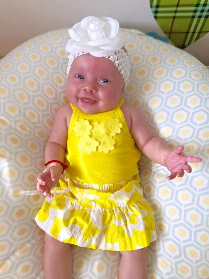 Spring is here! Check out this adorable GG baby girl in her April yellow!