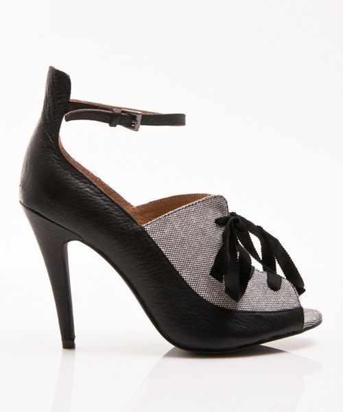 Elevated to posh perfection, the leather andfabric upper of this pump is pure luxe, while the ankle-strap silhouette and statement-making heel promise sleek style.3.75'' heelBuckle closureLeather / fabric upperMan-made sole