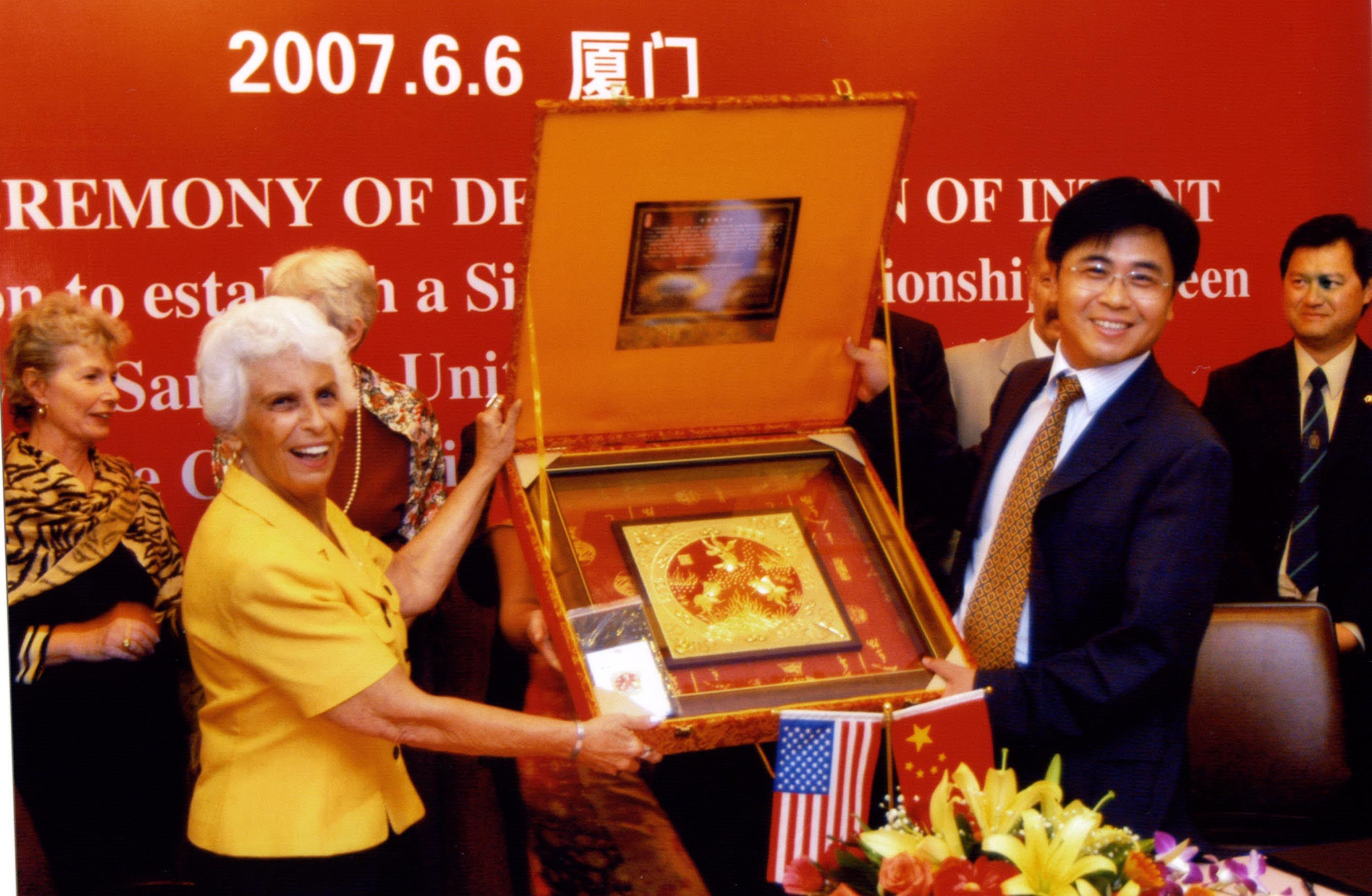 Mayor Lou Ann Palmer accepts a gift at formal twinning ceremonies between Xiamen, China and Sarasota in June 2007