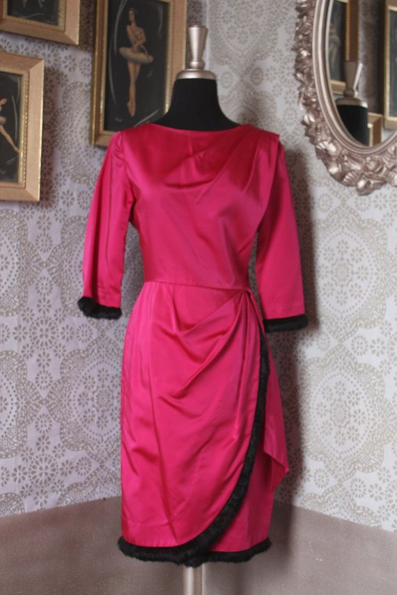 Lovely magenta dress trimmed in dark brown/black rabbit fur. The dress has a side nylon zipper and gorgeous draping on the left shoulder a hip.
