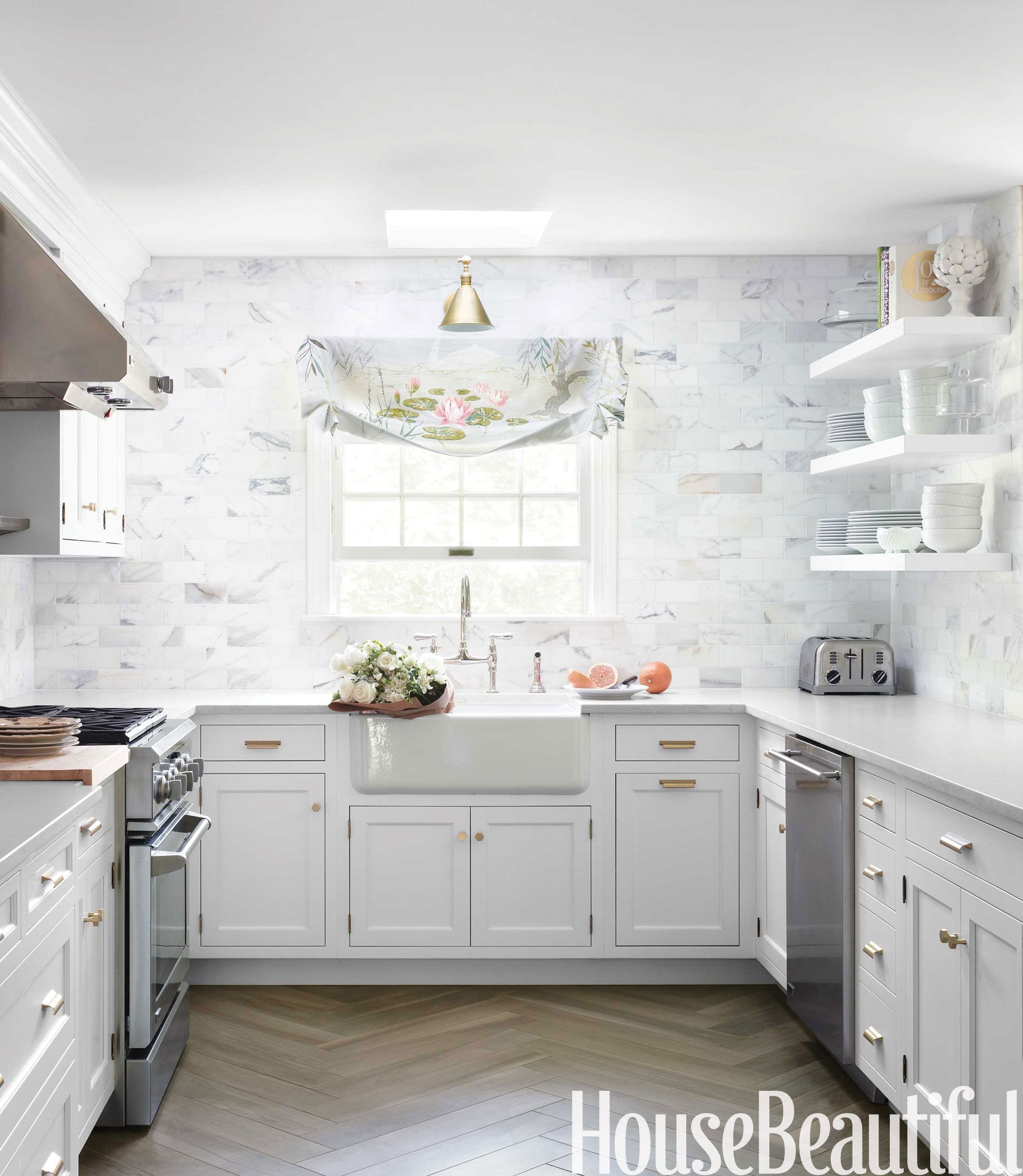 A classic white kitchen in new jersey calacatta gold marble the movement and color in calacatta gold marble subway tiles create a dynamic backdrop in a dailygadgetfo Images