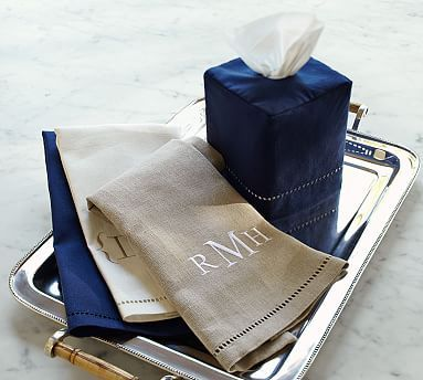 We love this simple linen look and think the using the Driftwood color would work well Linen Hemstitch Guest Towels, Set of 2 from Pottery Barn (Monogramming is available for an additional charge)