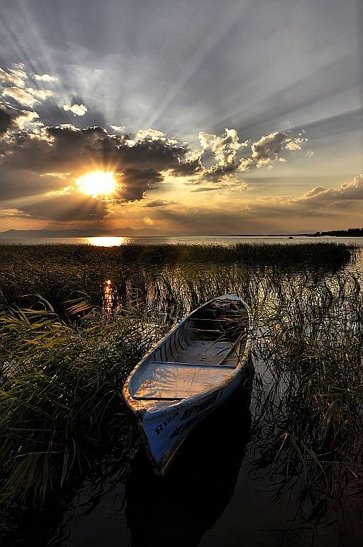 Beautiful sunset with old canoe