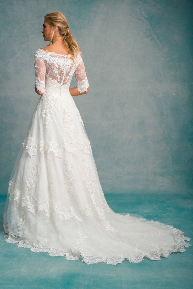 A haute couture wedding gown designed using the finest French cotton ...