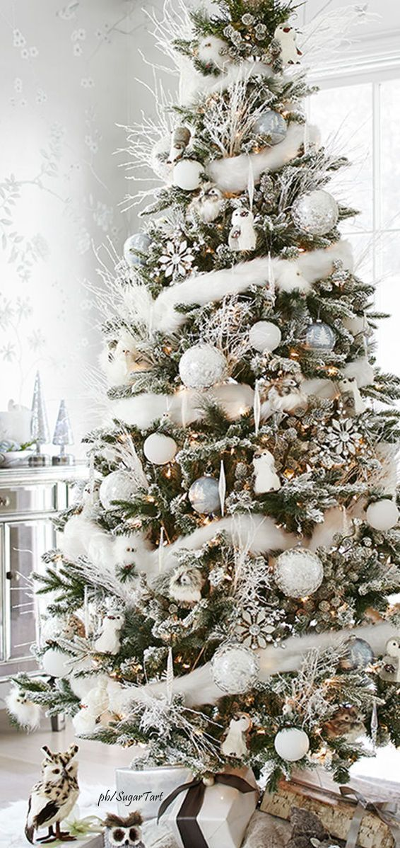 holiday decorating white on white christmas tree with woodland creatures and white branches