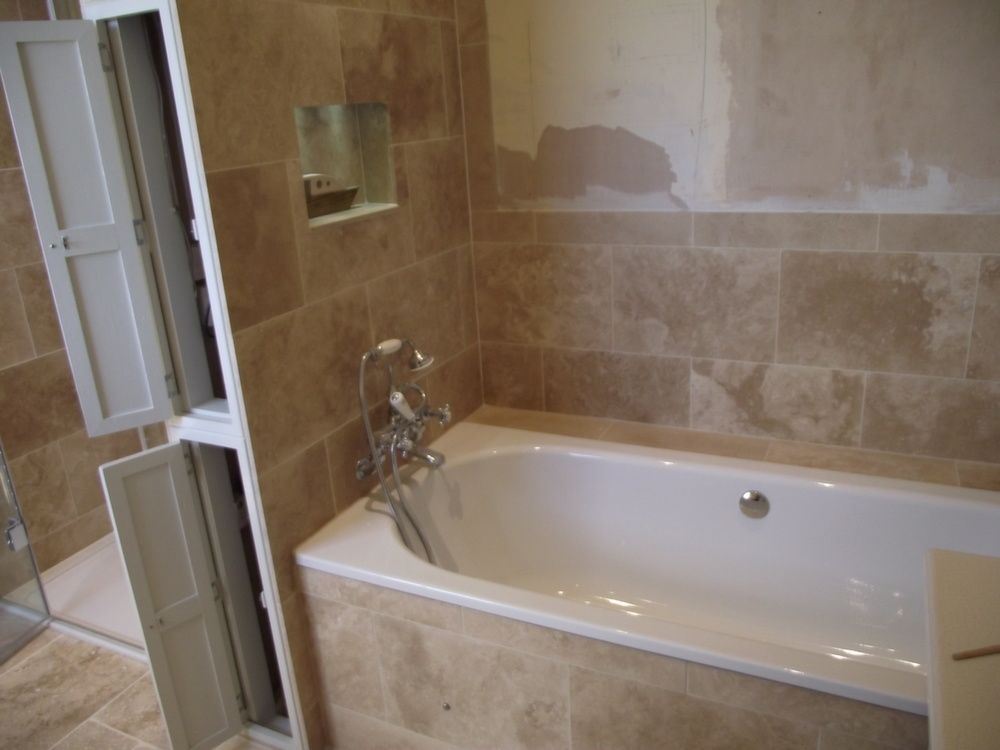 Bath side of stud wall showing recess and access doors | Earth ...