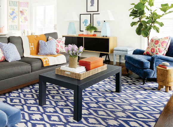 Grey Couch With Navy Graphic Rug Blue Chairs Pops Of Orange Black Coffee Table