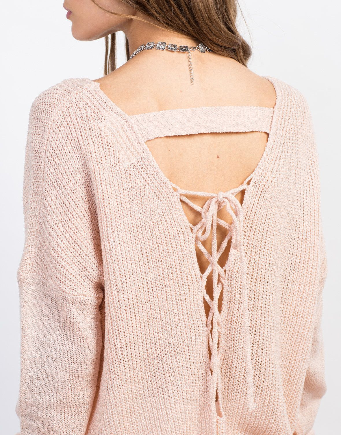 a704396da3 Stay cool this season in the Lace-Up Back Knit Sweater! Pair this knit