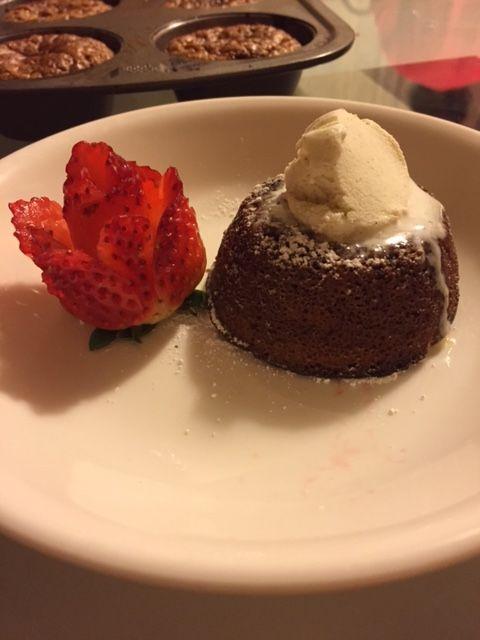 Milk chocolate lava cake with a strawberry rose.