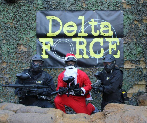 Santa Claus and two elves posing for a photo at Delta Force Paintball