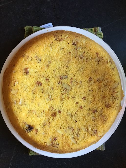 Heat the oven to 350°F. Grease the bottom and sides of a 9- or 10-inch springform pan and add a parchment circle. Whisk together the flour, cornmeal, baking powder, baking soda, and salt in a medium bowl and set aside. In another bowl, whisk together the sugar, eggs, vanilla, lemon zest, and lemon juice until …