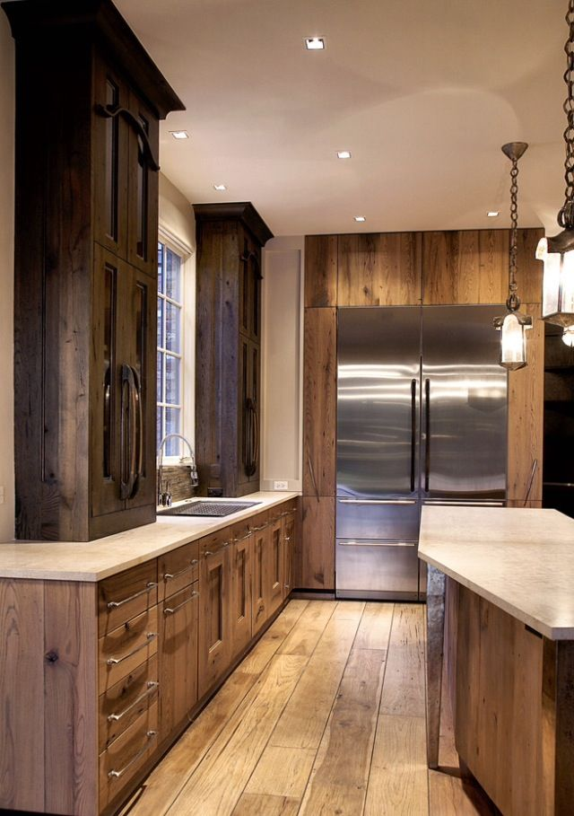 Wide plank floor. Light cabinets on bottom with dark on ...