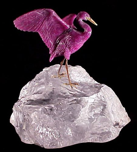 "This heron of carved ruby has 18k gold legs and beak. The piece stands 5-1/2"" high, including its rock-crystal quartz base. It is the work of Gerhard Becker of Idar-Oberstein, Germany,"