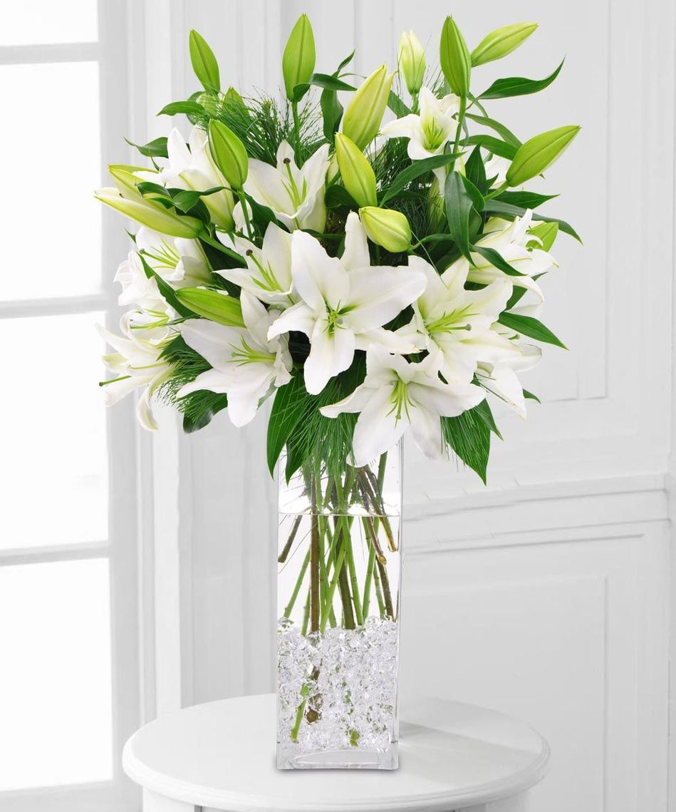 A tall vase of oriental lilies is on everyones holiday list white lily flower arrangements for weddings sale 17923 lily flower izmirmasajfo
