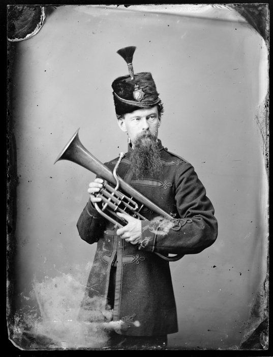 Unnamed bandsman, in uniform of Wanganui Rifle Volunteers, with euphonium