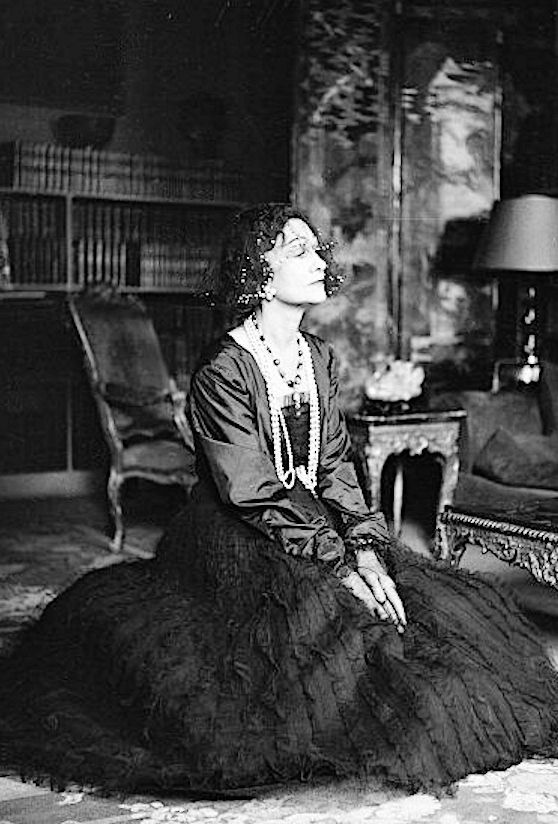 Gabrielle Coco Chanel, (67), in her Paris apartment, Photo by Walter Carone, 1950