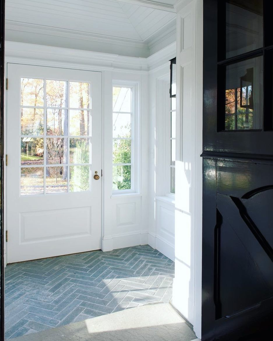 Very Beautiful Entry With Grey Fishbone Flooring And The Black