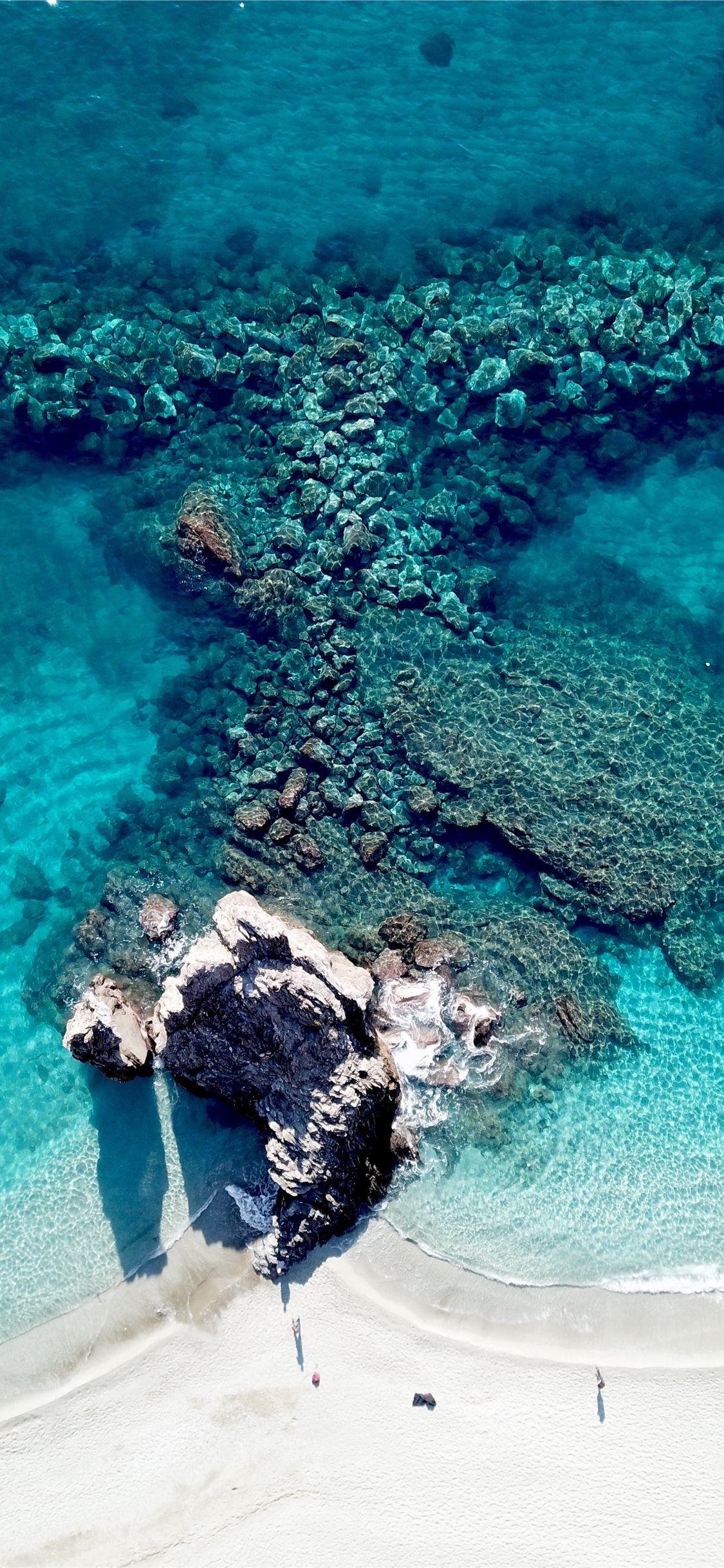 bird's eye view photography of white sand seashore water