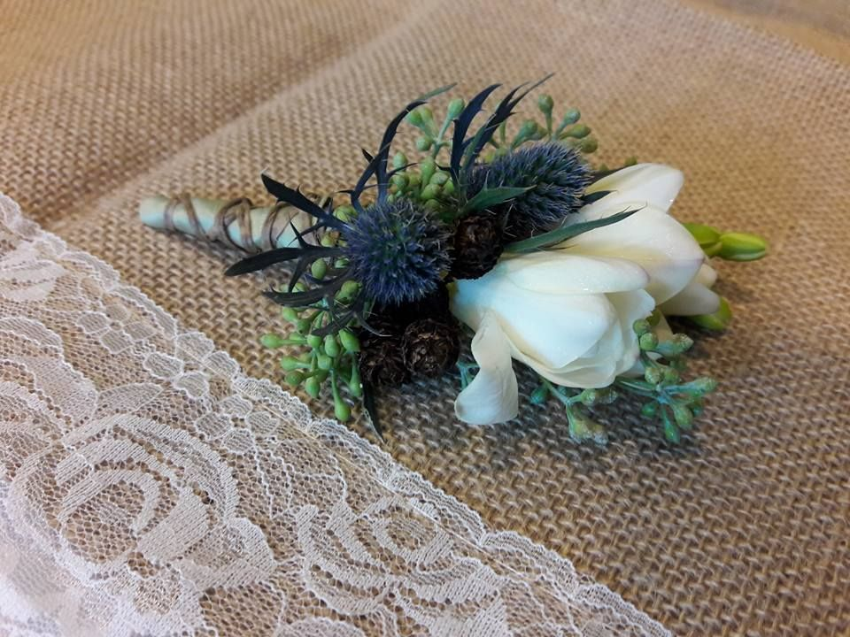 A wonderful combination of freesia and blue thistle