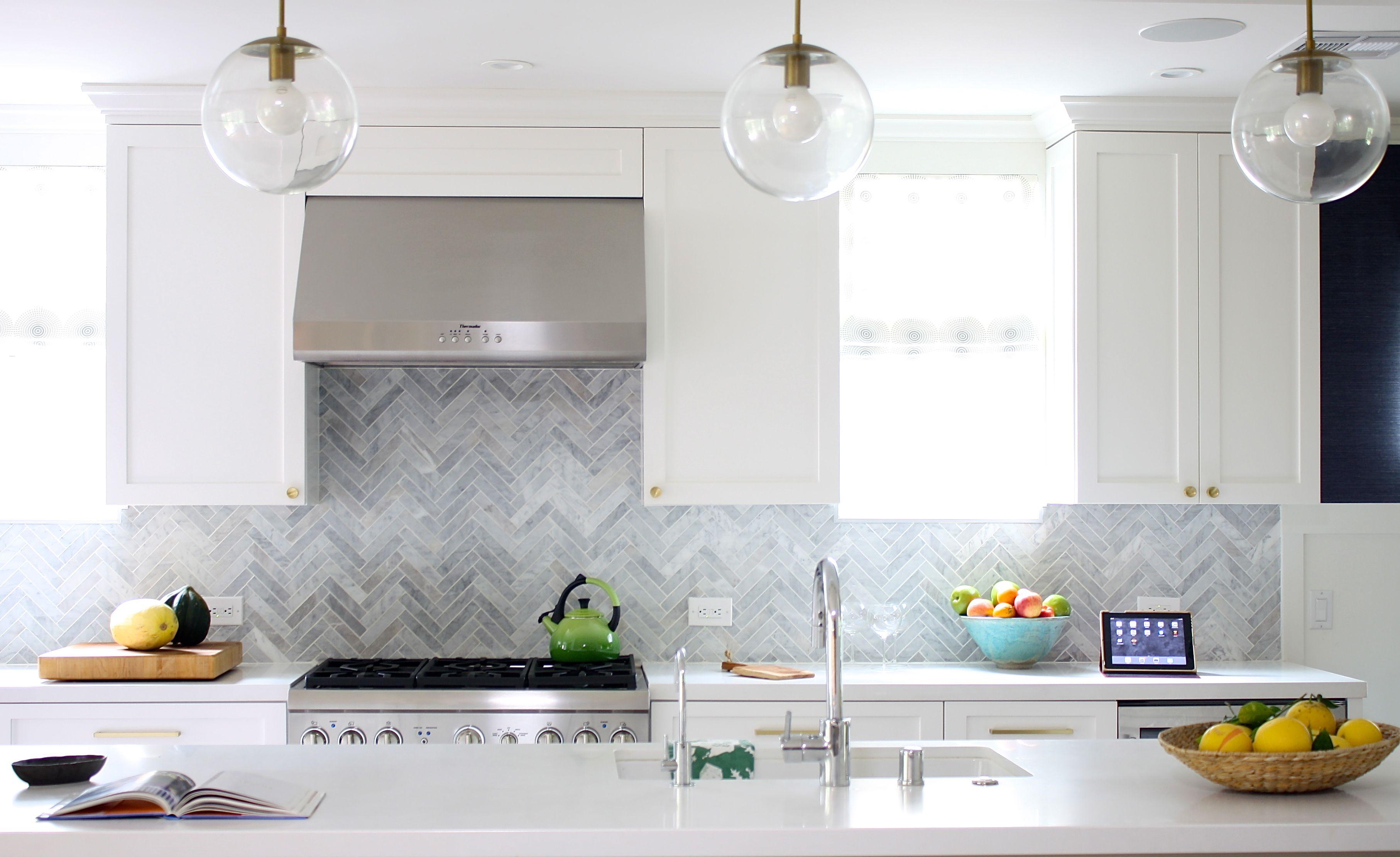 White Kitchen Herringbone Marble Backsplash Schoolhouse Electric Pendants Herringbone Backsplash Contemporary Kitchen Kitchen Marble