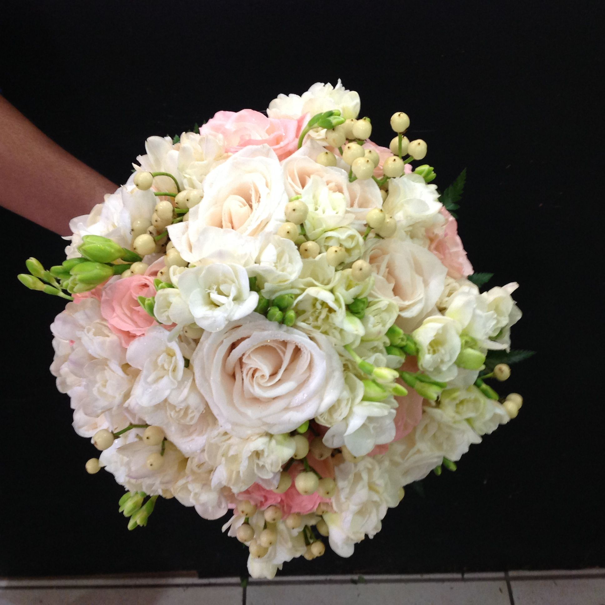 7e5232a904 Hand Tied Bridal Bouquet done with Ivory Roses, Pale pink Roses, White  Freesias and Hypericum Berries. Stems Wrapped with Sheer Ivory Ribbon.