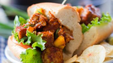Fantastic vegan sandwiches that are made with tasty pan-fried tempeh which is mixed with a wonderful mango barbecue sauce made with mango puree! They are ready in less than 30-minutes, and they are super simple to make. These delicious sandwiches are perfect for a quick and tasty meal! #vegan #recipes #veganfood #sandwiches #tempeh #lucnh