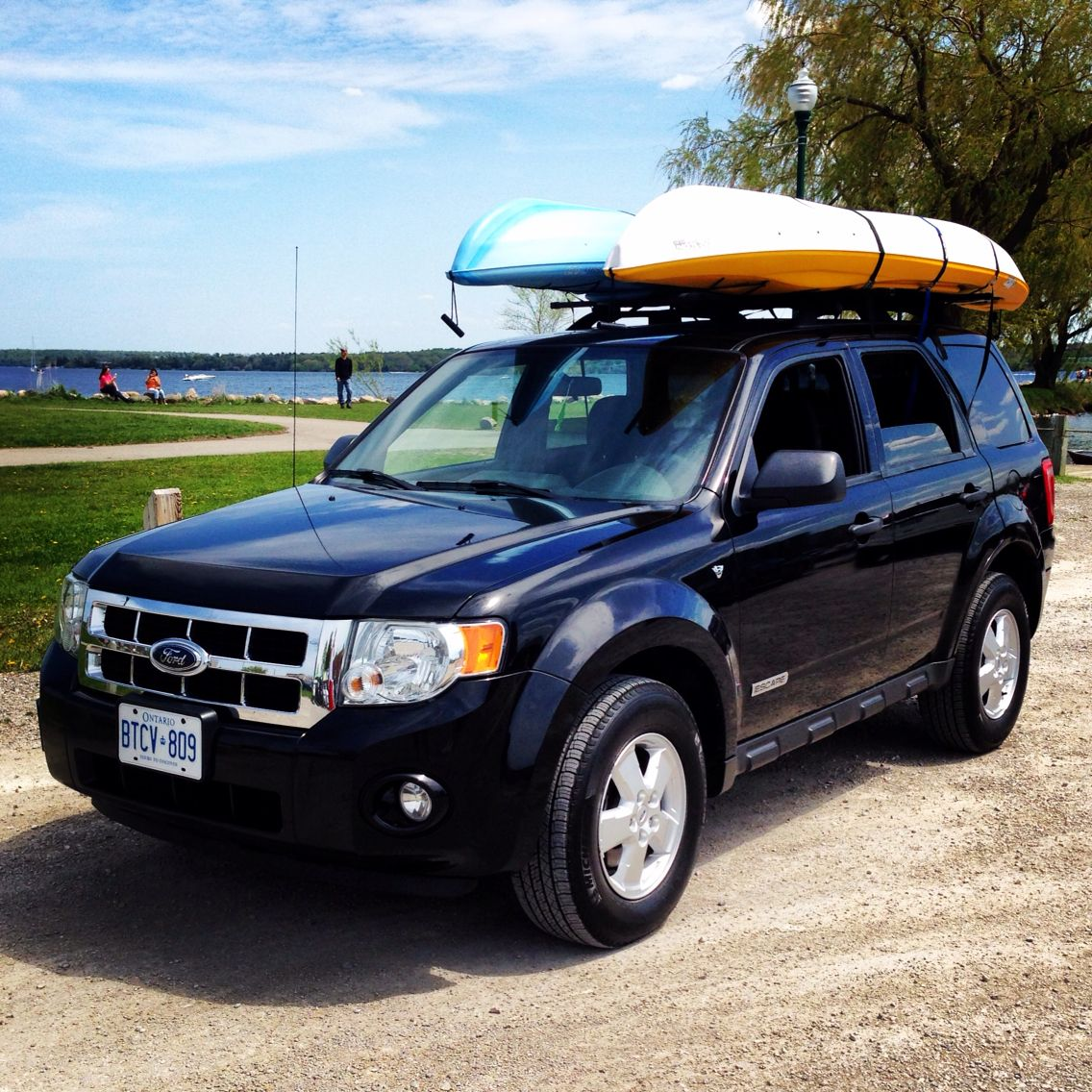 My Ford Escape Is Great For Summer Recreation And The Aftermarket Sportrack Roof Racks Allow Me To Put 2 Kayaks Side By Ford Escape Kayak Roof Rack Car Camping