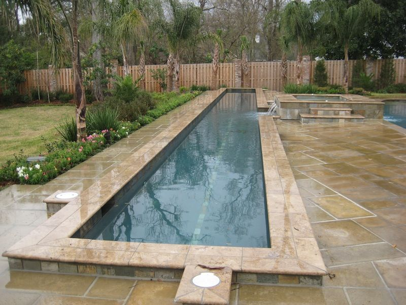 Luxury raised lap pool with noche mexican travertine for Raised pool designs