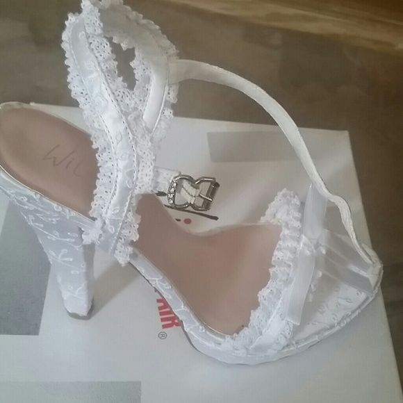 Brand new never worn shoes Very Sexy white lace 5 inch strap on sandles. Wild Pair Shoes
