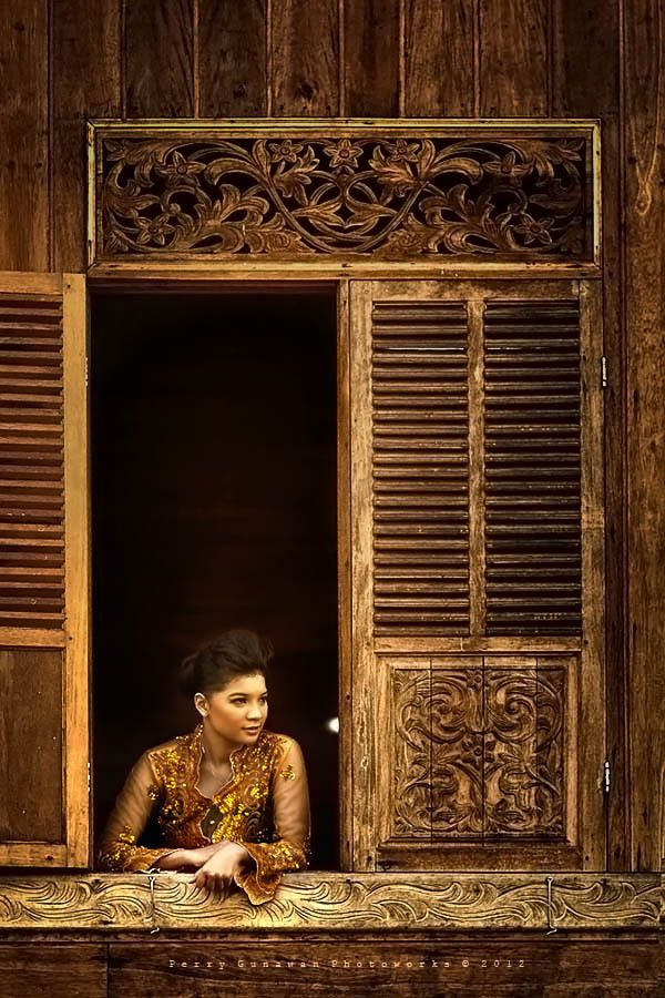 Golden girl at the window by Perry Gunawan via MaxiReporter.