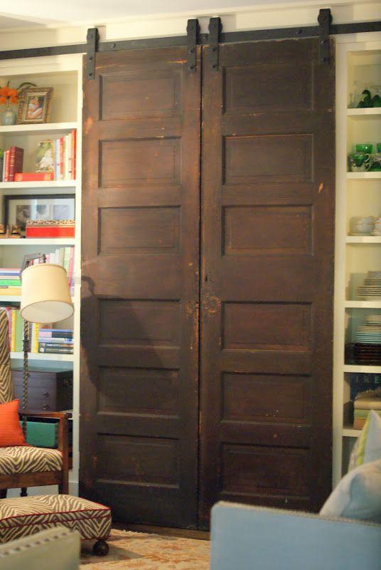 TV behind barn doors