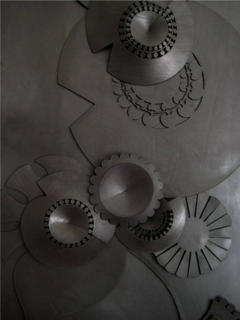 Leather Wall Panel Reminiscent of Cogs and Wheels | From a unique collection of antique and modern wall-mounted sculptures at https://www.1stdibs.com/furniture/wall-decorations/wall-mounted-sculptures/