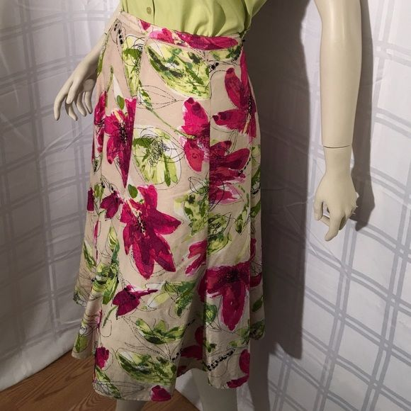 Super Pretty Embellished floral skirt Pretty and femme Chico's floral lined skirt with side zipper. Lightly loved with no stains. Chico size 1 = Small/med. Chicos Skirts A-Line or Full