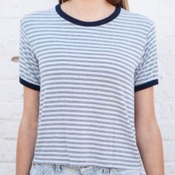 Brandy Melville blue and white stripped Nadine top Brandy Melville blue and white stripped Nadine top! Not sure if I fully want to sell or not but it's only been worn twice and in great condition! Open to trades for my ISO's!:) Brandy Melville Tops Tees - Short Sleeve