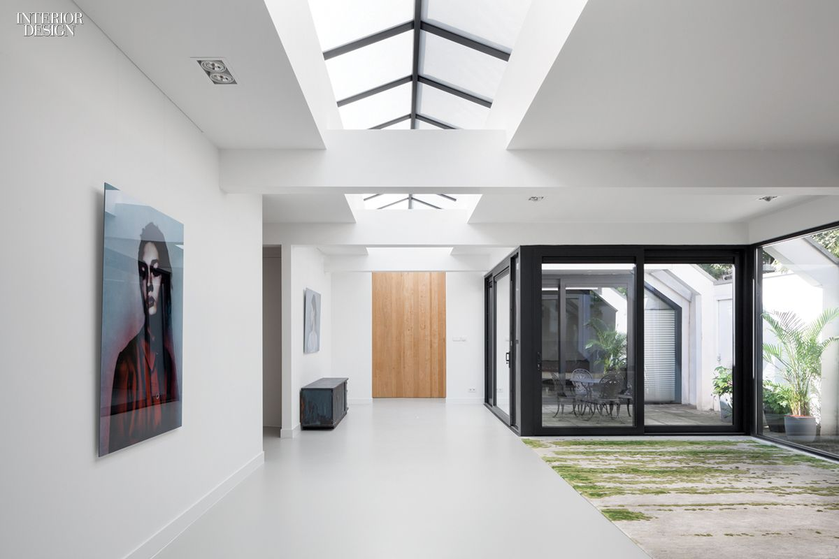 Epoxy flooring, poured over an existing concrete slab, extends from the living area to the patio. Photography by Ewout Huibers.